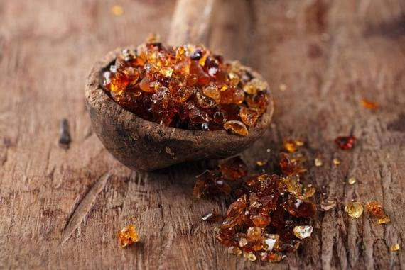 Gum Arabic, Also Known As Acacia Gum In Old Wooden Spoon